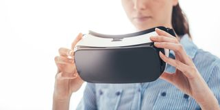 Woman holding a VR headset Royalty Free Stock Photo