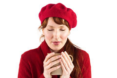 Woman holding a warm cup Royalty Free Stock Images