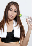 Woman holding  water. Tired Workout college woman and holding fresh water Stock Photo