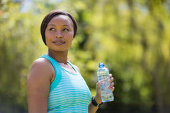 Woman holding water bottle Royalty Free Stock Photo