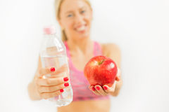 Woman holding water bottle and apple Royalty Free Stock Images