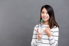 Woman holding water bottle and showing thumb up Stock Photos