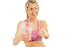 Woman holding a water bottle and showing thumbs up Stock Image
