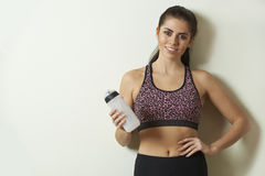 Woman Holding Water Bottle Taking Break During Exercise Royalty Free Stock Photo