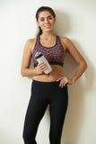 Woman Holding Water Bottle Taking Break During Exercise Stock Photo
