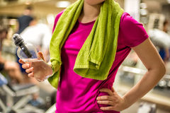 Woman holding water in the gym Stock Images