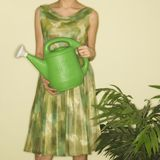 Woman holding watering can. Royalty Free Stock Photo