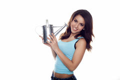 Woman holding a watering can. Stock Photos
