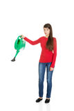Woman holding a watering can. Stock Images