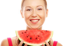 Woman holding watermelon ready to take a bite Stock Images
