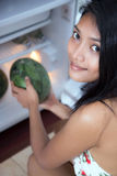 Woman holding a watermelon Stock Images