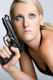 Woman Holding Weapon. Beautiful sexy woman holding weapon Stock Image