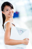 Woman holding a weight scale Stock Image