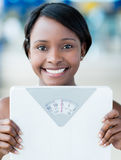 Woman holding weight scale Royalty Free Stock Images
