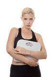 Woman holding weight scales Royalty Free Stock Images