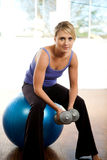 Woman holding weights Stock Photos
