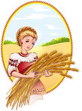 Woman holding wheat ears Stock Images