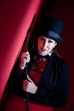 Woman holding whip and wearing top hat stock image