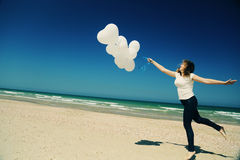 Woman holding white balloons Stock Image