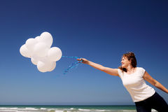 Woman holding white balloons Royalty Free Stock Images