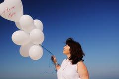 Woman holding white balloons Royalty Free Stock Photos