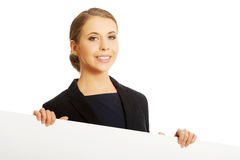 Woman holding white banner Stock Photos