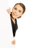 Woman holding white banner Stock Images