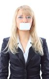 Woman holding a white card, covering her mouth Stock Photo