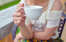 Woman holding white coffee cup Stock Photos