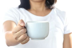 Woman holding a white coffee cup. Stock Photos