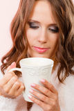 Woman holding white mug with coffee warm beverage Stock Images