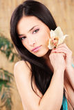 Woman holding white orchid stock photo