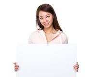 Woman holding with white poster Royalty Free Stock Photos