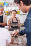 Woman holding a white salmon Stock Photography
