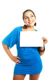 Woman holding a white sheet of paper Stock Image