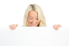 Woman holding a white sign Stock Photography