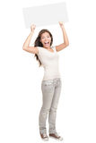 Woman holding white sign cheering. Blank sign. Woman holding empty blank white sign above her head. Excited and screaming beautiful young woman isolated on white Royalty Free Stock Image