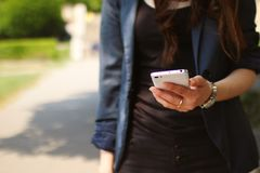 Woman Holding White Smartphone Stock Images