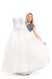 Woman holding a white wedding dress Royalty Free Stock Images