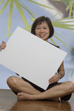 Woman holding whiteboard Royalty Free Stock Photo