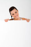 Woman holding whiteboard Stock Images