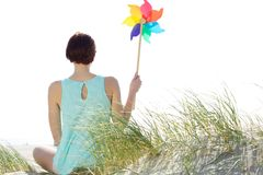 Woman holding wind pinwheel Stock Photo