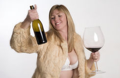WOMAN HOLDING WINE BOTTLE AND GLASS - 01 2016 - Royalty Free Stock Image