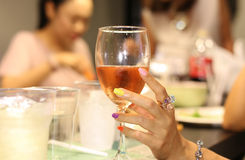 Woman holding a wine glass Royalty Free Stock Photos