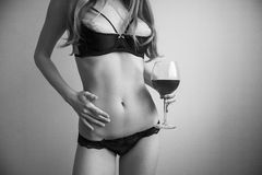 Woman holding wine glass. Royalty Free Stock Photography