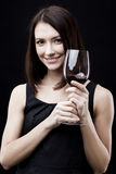 Woman holding wine glass Stock Photography