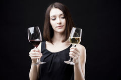 Woman holding wine glass Stock Images