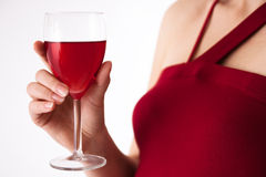 Woman holding wineglass. Isolated. Royalty Free Stock Photo