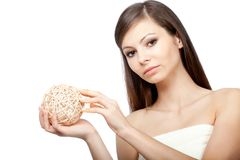Woman holding wooden ball Royalty Free Stock Photo