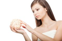 Woman holding wooden ball Royalty Free Stock Image